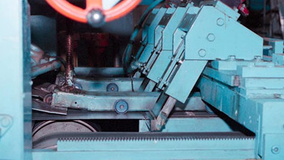 Steel strips being cut and processed